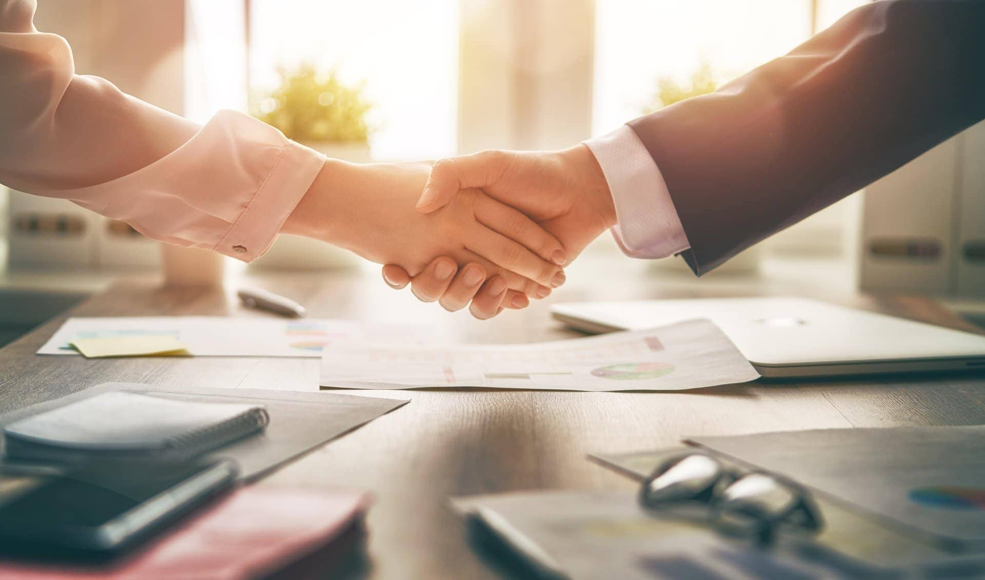cpa las vegas shaking hands with small business owner